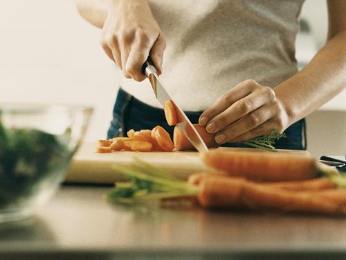 cutting board with food. 01-woman-chopping-vegetables-cutting-board-kitchen-lgn Cutting Board With Food